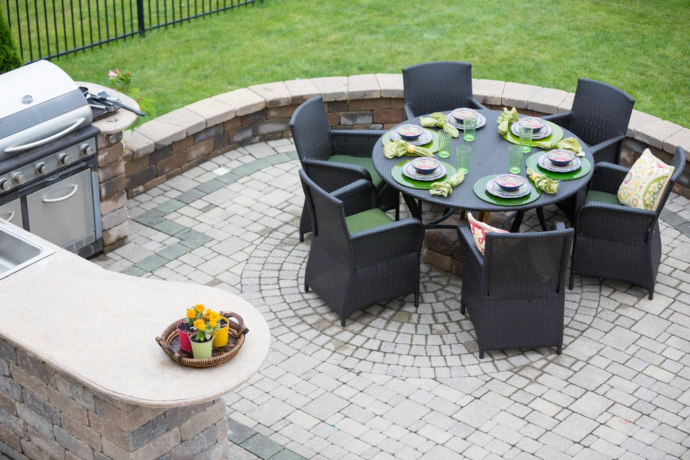outdoor kitchen and paver patio